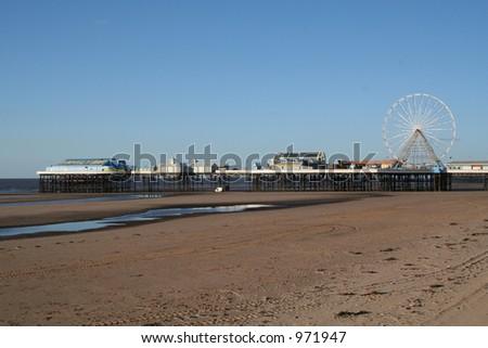 Central Pier, blackpool with ferris wheel, fun fair and family bar.