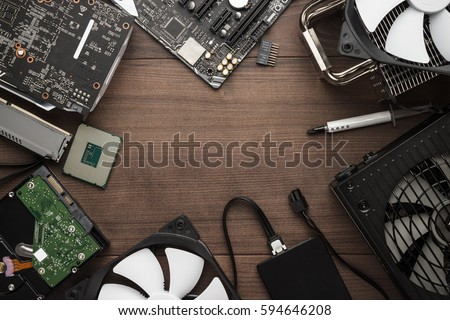 central processing unit and other computer parts on the wooden table with copy space. building personal gaming and video production pc concept #594646208