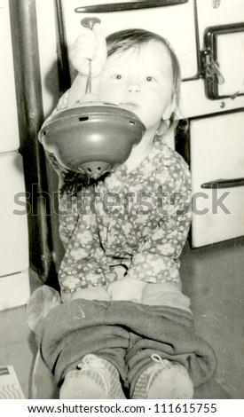 Central Slovakia, CZECHOSLOVAK REPUBLIC, CIRCA 1974 - baby sitting on the potty - circa 1974