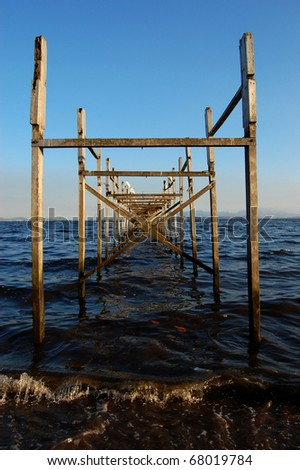 Centralized view of an old pier structure made of wood - stock photo