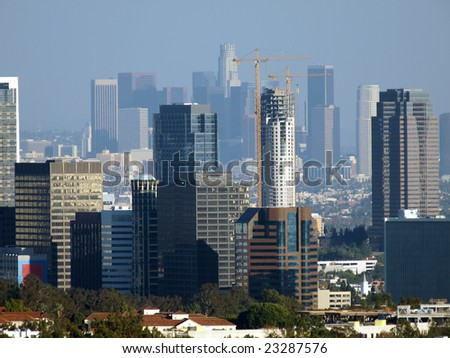 Century City and Downtown Los Angeles form a double skyline in the afternoon sun.