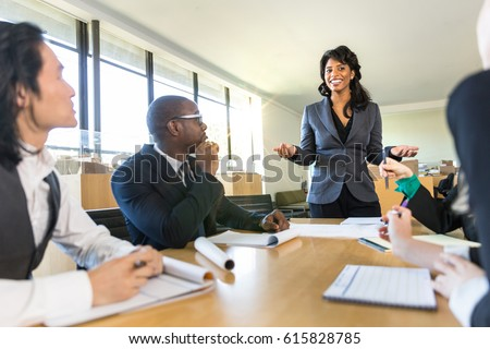 CEO boss female speaker manager presenting a lecture in the boardroom office workplace to colleagues