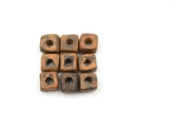 Ceramic bead made of baked clay square shape with blackening