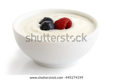 Ceramic bowl of white yogurt with berries isolated on white background. #449274199