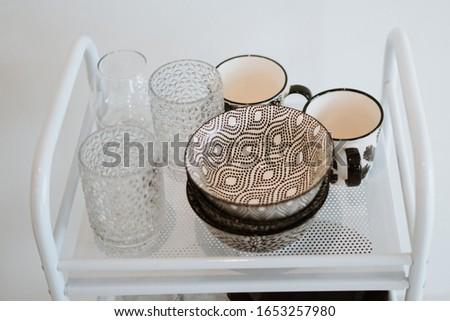 ceramic bowls close-up. empty glasses. kitchen utensils
