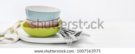Ceramic bowls with silver cutlery #1007563975