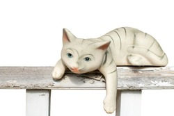 Ceramic cat on the fence, On white background.
