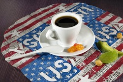 ceramic coffee cup on american flag background