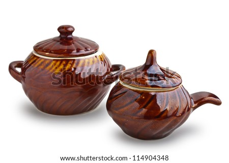 Ceramic cooking pots on white background with soft shadow
