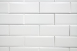 Ceramic decorative tiles of simple texture covering walls of kitchen, bathroom or toilet, old vintage style and white color