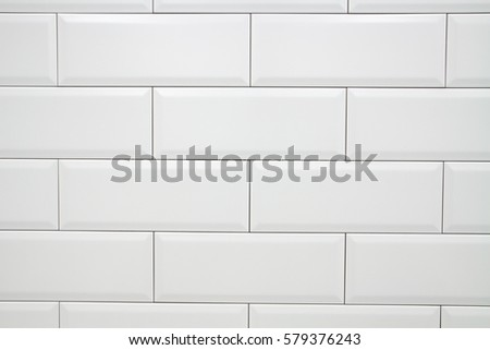 Ceramic decorative tiles of simple texture covering walls of kitchen, bathroom or toilet, old vintage style and white color #579376243