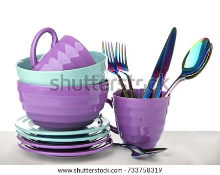 Ceramic dishware and cutlery on white background #733758319