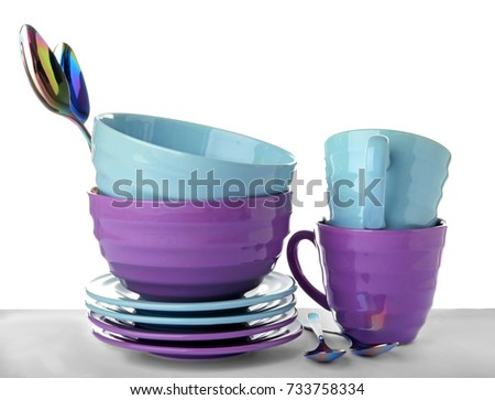 Ceramic dishware and cutlery on white background #733758334