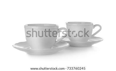 Ceramic dishware on white background #733760245