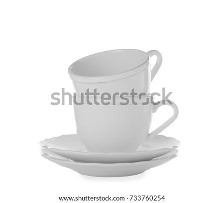 Ceramic dishware on white background #733760254