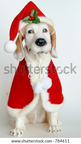 ceramic  dog dressed in santa outfit