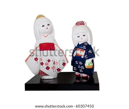 Ceramic dolls of two young japanese girls in kimonos - stock photo