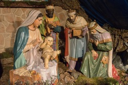 ceramic figures representing the adoration of the Magi in a Christmas nativity