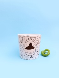 Ceramic flower pot with hand drawn doodle illustrations and a green pepper as a planting and gardening concept on blue background