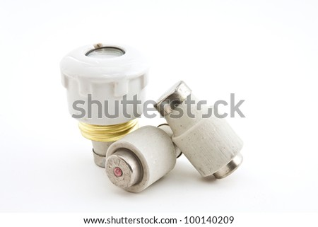Ceramic fuses for domestic electrical installation on a white background