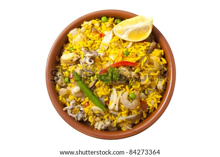 Ceramic plate with paella isolated on a white background