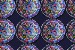Ceramic plates and bowls on fair. Kitchen utensils.