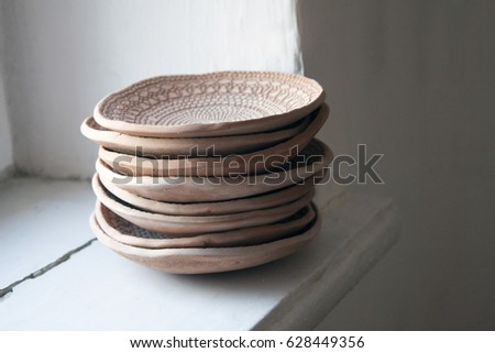 Shutterstock Ceramic plates from red clay