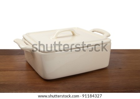 Ceramic pot for stove on wooden kitchen board