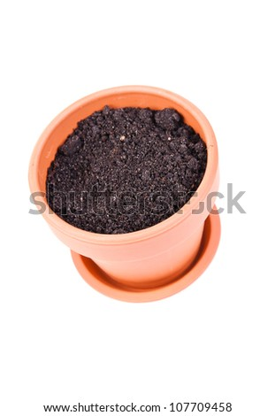 ceramic pot with soil on a white background