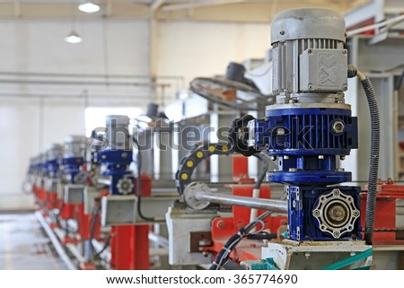 ceramic production machinery and equipment in a factory, closeup of photo