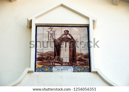 Ceramic saint picture on the wall of the Santo Domingo de Guzman church, Benalmadena Pueblo, Costa del Sol, Andalusia, Spain, Europe.