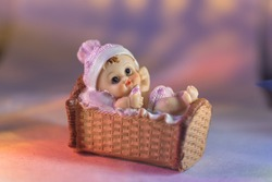 Ceramic Sculpture of a baby sleeping in a bassinet