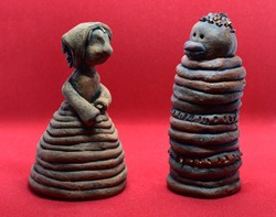 Ceramic statuette of a peasant woman and an African statuette of a man