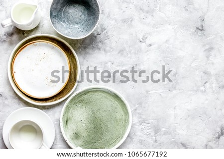 ceramic tableware top view on stone background mock up #1065677192