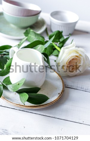 ceramic tableware with flowers on white background #1071704129