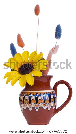 Ceramic vase with an artificial flower and multicolored spikes