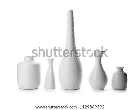 Ceramic vases on white background #1129869392