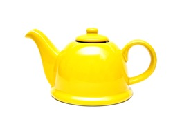 Ceramic yellow teapot on a white background. Isolate. Place for an inscription. Vintage teapot.Tea infuser.Kitchen utensils.Yellow color. Bright photo. Pottery Kettle. Copy space. Tea ceremony