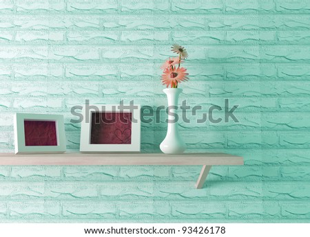 ceramics vase with flower and two picture frames on the shelf, 3d render