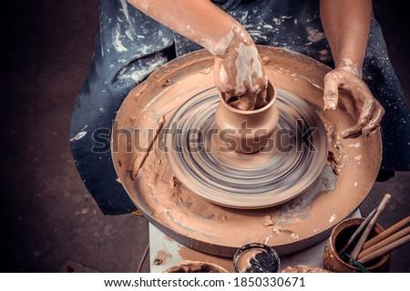 Ceramist master enjoying pottery art and production process. Handicraft. Close-up. Stock fotó ©