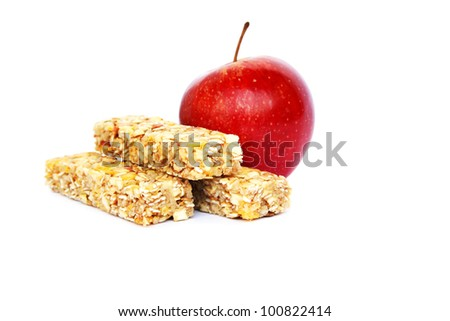 Cereal bars with apple isolated on white background.