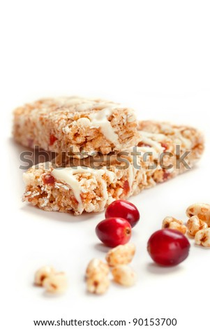 Cereal bars with puffed wheat and cranberries, closeup shot, focus on wheat flakes