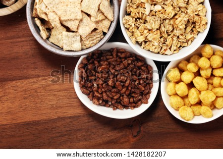 Cereal. Bowls of various cereals and milk for breakfast. Muesli with variety of kids cereals. #1428182207