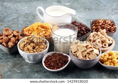 Cereal. Bowls of various cereals and milk for breakfast. Muesli with variety of kids cereals. #1429818020