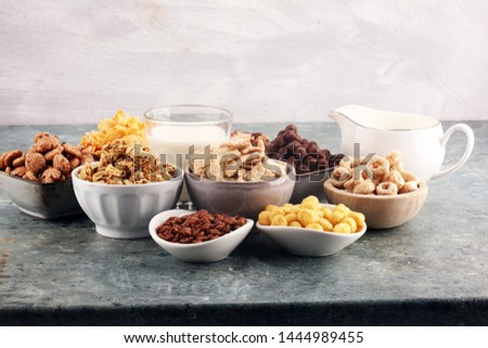 Cereal. Bowls of various cereals and milk for breakfast. Muesli with variety of kids cereals. #1444989455