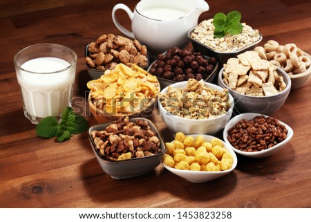 Cereal. Bowls of various cereals and milk for breakfast. Muesli with variety of kids cereals. #1453823258