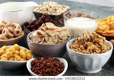 Cereal. Bowls of various cereals and milk for breakfast. Muesli with variety of kids cereals. #1453823312