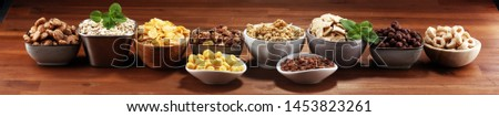 Cereal. Bowls of various cereals for breakfast. Muesli with variety of kids cereals. #1453823261