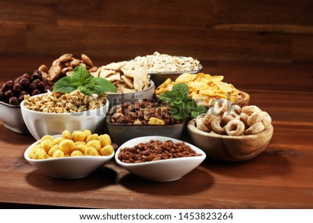 Cereal. Bowls of various cereals for breakfast. Muesli with variety of kids cereals. #1453823264
