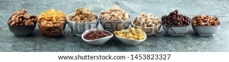 Cereal. Bowls of various cereals for breakfast. Muesli with variety of kids cereals. #1453823327